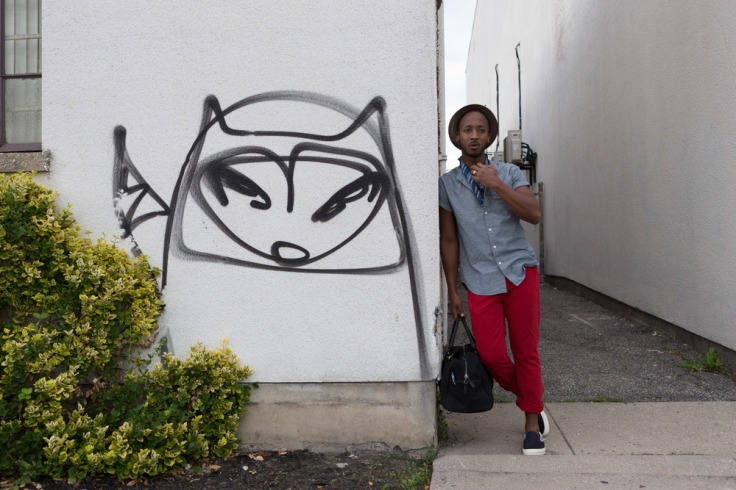 Frontman Style - Diasappearing Racoon_leaning against wall with no sunglasses
